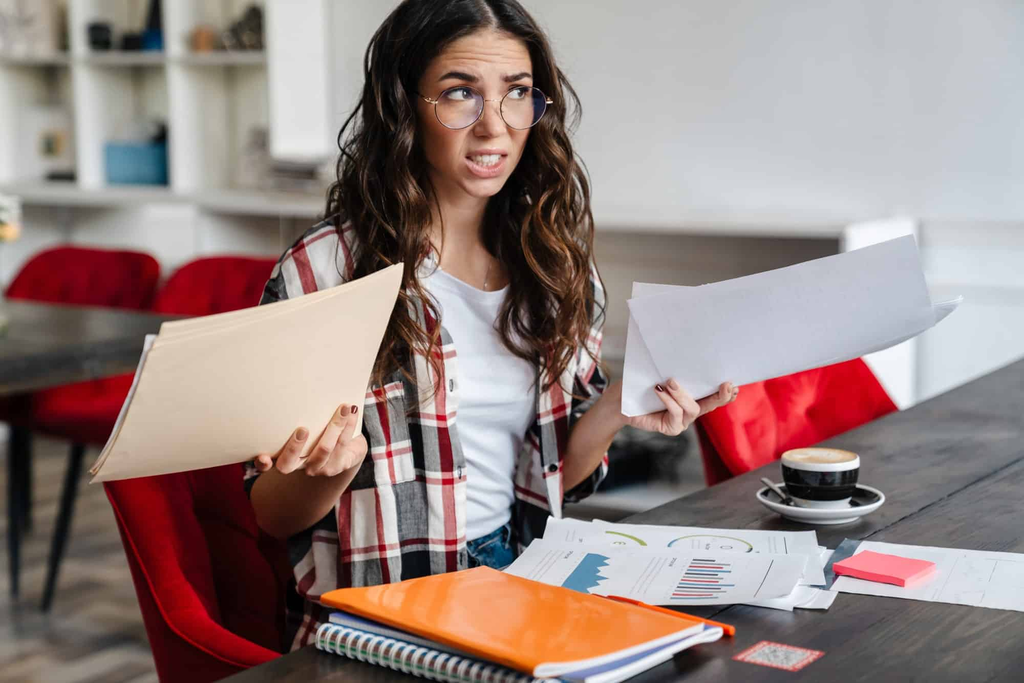 Confused fruustrated young woman working