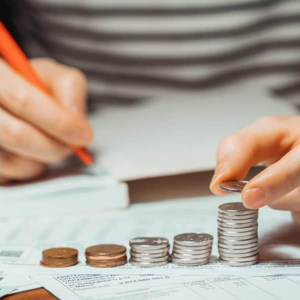 male businessman calculating stacking coin saving money for home financial accounting, retirement. F