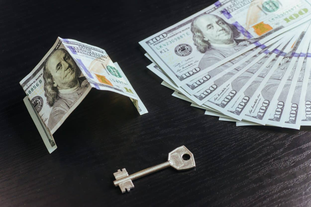 Mortgage, investment, real estate and property concept. Dollar money house keys