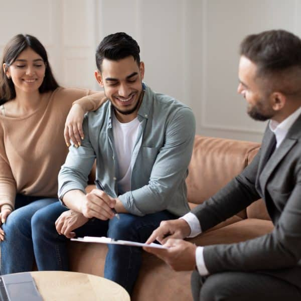 Real Estate Agent Showing Buyers Contract, Man Signing
