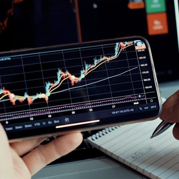Stock market trader analyzing bitcoin price trend