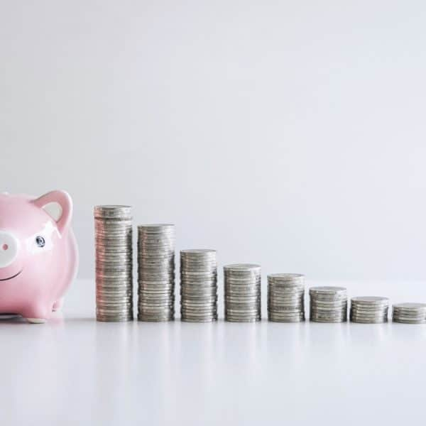 Images of stacking coins pile and pink smiling piggy bank to growing and savings with money box