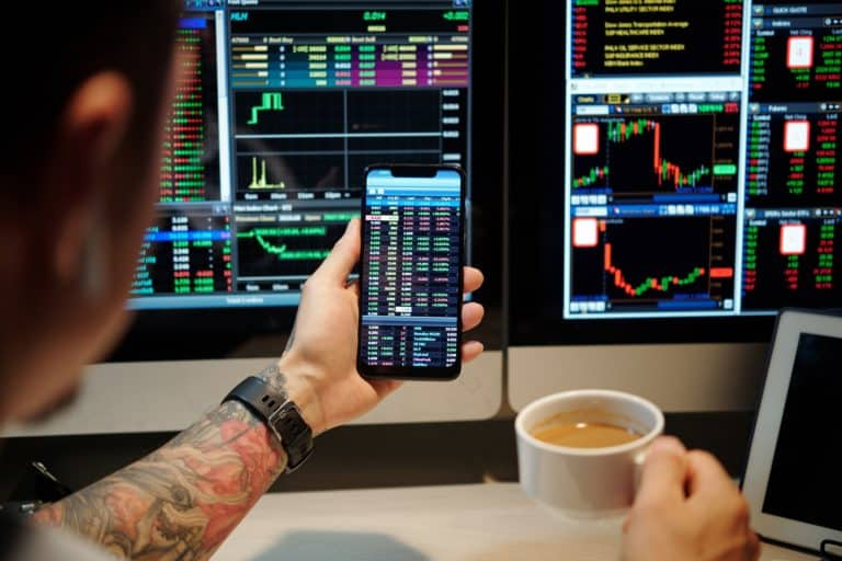 Trader Checking Shares Prices via App